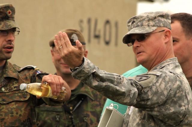 Lt. Col. David Englerth, U.S. Army Europe lead planner for exercise Combined Endeavor 2011, speaks with partner nation representatives during set-up for Combined Endeavor Sept. 9 in Grafenwoehr, Germany.