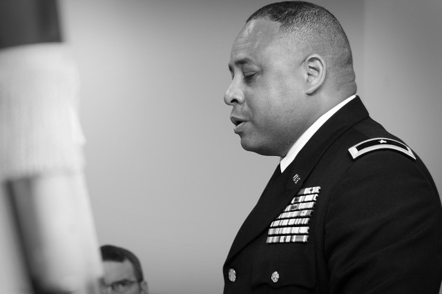 "Brig. Gen. Gracus Dunn, Commanding General of the 85th Support Command, takes a few moments in prayer during a 9/11 "" 10 year remembrance hosted by the 85th Support Command Equal Opportunity Office at their headquarters in Arlington Heights, IL, Sep 11. Later that same day Brig. Gen. Dunn also attended a 9/11 commemorative event held by the Village of Buffalo Grove where Brig. Gen. Dunn gave a brief surprise performance of orchestrating The Buffalo Grove Symphonic Band. U.S. Army photo by Sgt. Carrie Castillo, 85th Support Command Public Affairs Office."