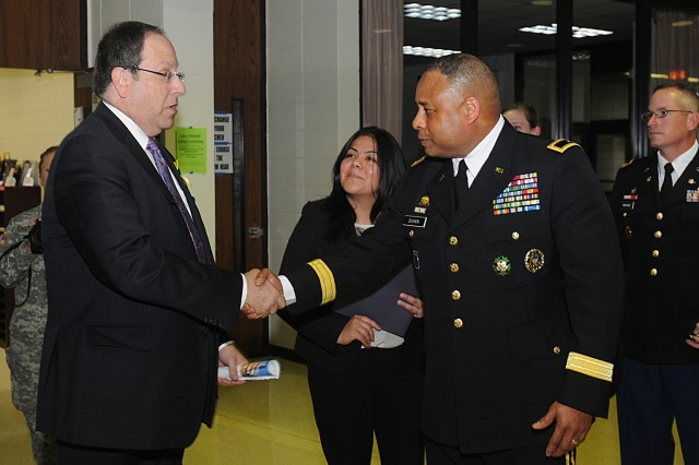 President, Village of Buffalo Grove, Jeffrey S. Braiman, meets The Commanding General of the 85th Support Command, Brig. Gen. Gracus Dunn, accompanied by his protocol officer, Roxanna Zadlo, prior to The Buffalo Grove 9/11 10 year Commemorative event held at Buffalo Grove high school, Sep 11.Dunn, along with other community leaders, was invited to the event by the Village of Buffalo Grove to speak to the community about 9/11 in looking back at the last 10 years.U.S. Army photo by SSG Anthony L Taylor, 85th Support Command Public Affairs Office.