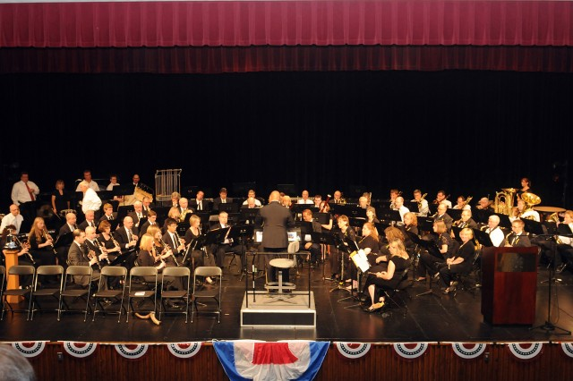 "Brig. Gen. Gracus Dunn, Commanding General of the 85th Support Command, conducts ""Stars and Stripes Forever""; with the Buffalo Grove Symphonic Band during The Buffalo Grove 9/11 10 year Commemorative event held at Buffalo Grove high school, Sep. 11. Dunn, who obtained a Bachelor of Arts, Music, was given a unique opportunity by the Conductor, Howard Green, to conduct towards the end of the event. With the fact that this event also was the 10 year anniversary for the Symphonic Band, Green wanted to honor the fallen of 9/11, the Fire, Police and Service-members who lost so many then and in the last 10 years. U.S. Army photo by SSG Anthony L. Taylor, 85th Support Command Public Affairs Office."