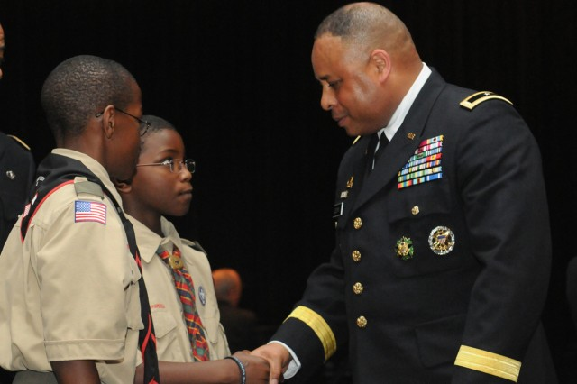 Members of Boy Scout Troop 100 meet and talk with Brig. Gen. Gracus Dunn, Commanding General of the 85th Support Command, following The Buffalo Grove 9/11 10 year Commemorative event held at Buffalo Grove high school, Sep. 11.Dunn was invited as a speaker to the event which opened him up at the end to take a lot of questions, remarks, and photos with citizens of Buffalo Grove and the surrounding communities.U.S. Army photo by SSG Anthony L. Taylor, 85th Support Command Public Affairs Office.