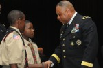 Members of Boy Scout Troop 100 meet and talk with Brig. Gen. Gracus Dunn, Commanding General of the 85th Support Command