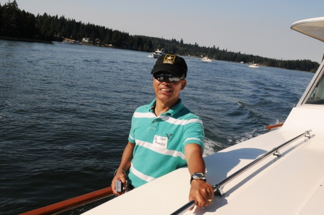 "OLYMPIA, Wash. "" Sgt. Maj. Rolando Munoz enjoys a ride on Hart to Hart, a yacht participating in the 49th Annual FOOFARAW, Sept. 9. Hosted by the Olympia Yacht Club and the Thurston County Chamber of Commerce, the event is a local tradition to honor military servicemembers. (U.S. Army photo by Sgt. Mark Miranda)"