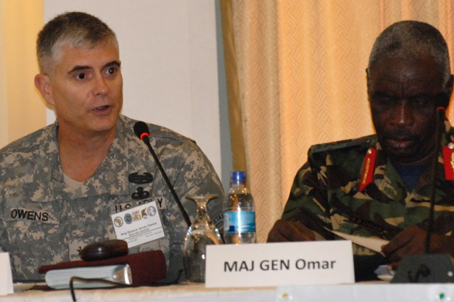 Brig. Gen. James Owens (left), Deputy Commanding General, Headquarters, U.S. Army Africa, welcomes participants from five East African countries to the first day of the Natural Fire 11 academics seminar Sept. 12 in Zanzibar, Tanzania. Maj. Gen. S.S. Omar, Commander of the Tanzania Navy, and the Natural Fire Exercise Director, is at right.