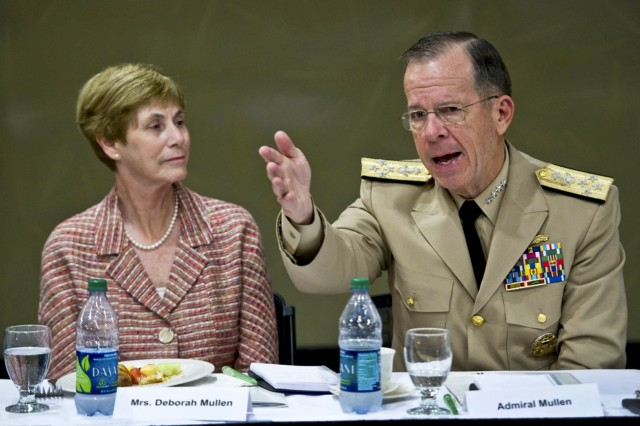 Deborah Mullen and Navy Adm. Mike Mullen, chairman of the Joint Chiefs of Staff, address business and civic leaders at a breakfast before a town hall meeting at the University of Miami in Coral Gables, Fla., Sept. 13, 2011.