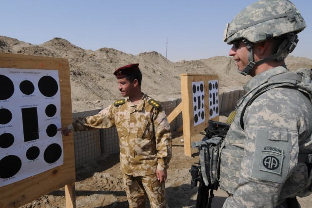 A paratrooper with the Stability Transition Team of the 82nd Airborne Division's 2nd Advise and Assist Brigade, and Capt. Ali Khalaf Sa'doon of the Iraqi army, take a look at their targets after firing some of the first rounds at the opening of the Anbar Operations Center's new range in Ramadi, Iraq, Sept 10, 2011. With a long history of supporting U.S. military operations in Iraq, the 2/82 and it's paratroopers are enabling the withdraw of U.S. military forces in Iraq.
