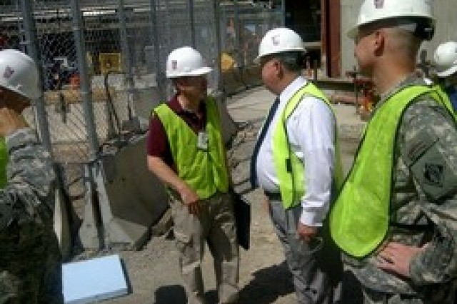 Under Secretary of the Army, HON Dr. Joseph W. Westphal, speaks with the Program Manager for the World Trade Center construction site, ground zero, during his visit in New York City, August 12, 2011. Dr. Westphal received a tour of the construction site and brief on the preparations being made to commemorate the 10th anniversary of the attack on the World Trade Center.