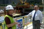 Under Secretary of the Army, HON Dr. Joseph W. Westphal, speaks with the Program Manager for the World Trade Center construction site, ground zero, during his visit in New York City, August 12, 2011.