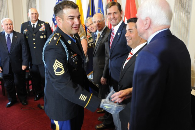 Medal of Honor recipient Sgt. 1st Class Leroy A. Petry reaches to shake hands with Sen. John McCain (R-AZ). Lookng on from left to right: Undersecretary of the Army Joseph W. Westphal, Army Chief of Staff Gen. Raymond T. Odierno, Sen. Jeff Bingaman (D-NM), Rep. Steve Pearce (R-NM), Rep. Martin Heinrich (D-NM) and Rep. Ben Ray Lujan (D-NM).