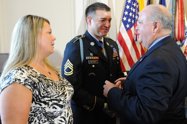 Undersecretary of the Army Joseph W. Westphal jokes with Medal of Honor recipient Sgt. 1st Class Leroy A. Petry and his wife Ashley in the reception line following a congressional resolution honoring the Soldier by the New Mexico delegation Sept. 13, 2011.