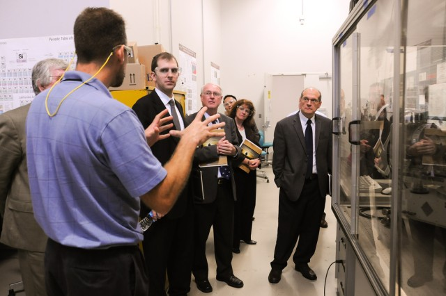 An Army Research Laboratory scientist leads University of Maryland-Baltimore County officials on a tour Sept. 14 at Aberdeen Proving Ground, Md.