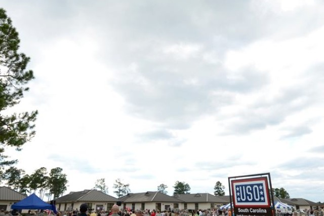 Spectators look above as two jets fly over as part of the USO in a Box ribbon-cutting ceremony last week at McCrady Training Center.