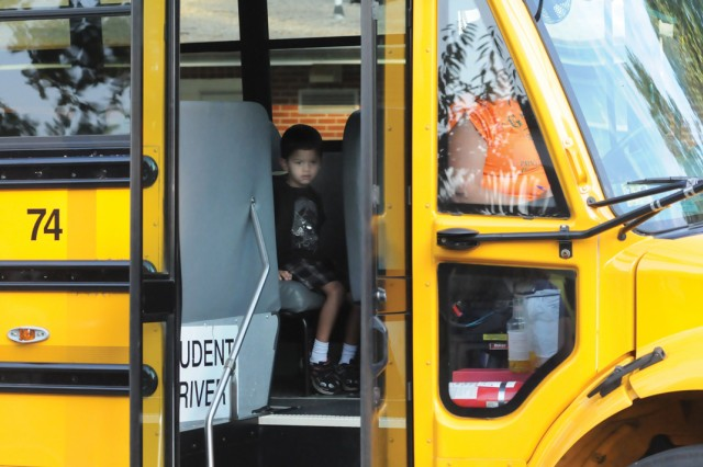 Zane Flores sits on the bus just before it pulls off to take him to Harrison Elementary School Sept. 12.