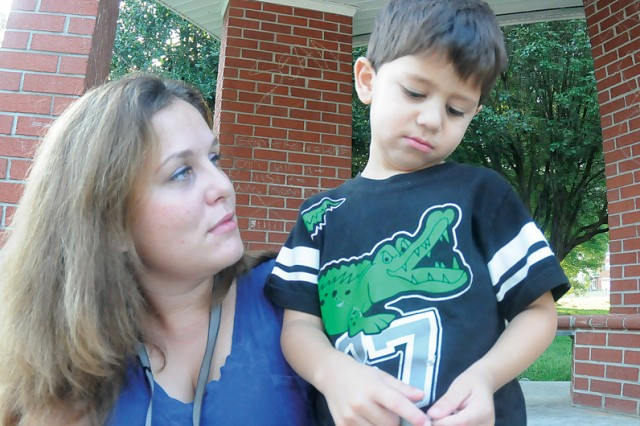 """Zane's playing partner and younger brother, 3-year-old Beau, wears a long face after seeing his brother board the bus for school.  """"I'm not worried much about Zane,"""" said Hollie Flores, Zane's mom.  """"I'm worried about Beau. I think he'll bug me all day about Zane."""""""
