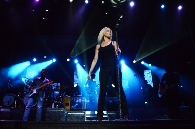 Kellie Pickler, country artist and former American Idol contestant, looks into the crowd during her performance at Saturday's Patriot Day concert at Hilton Field. Hundreds of concert-goers came out to support the joint effort between Operation Homefront and Family and Morale, Welfare and Recreation.