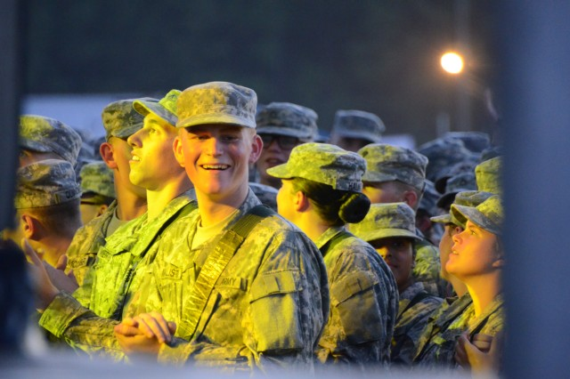 A Basic Combat Training Soldier claps along during the performances.