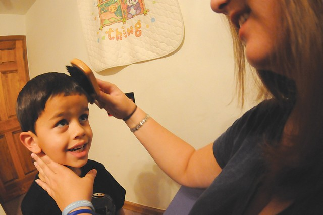 Full of energy and enthusiasm, Zane can hardly contain himself as his mother, Hollie, brushes his hair Sept. 12.