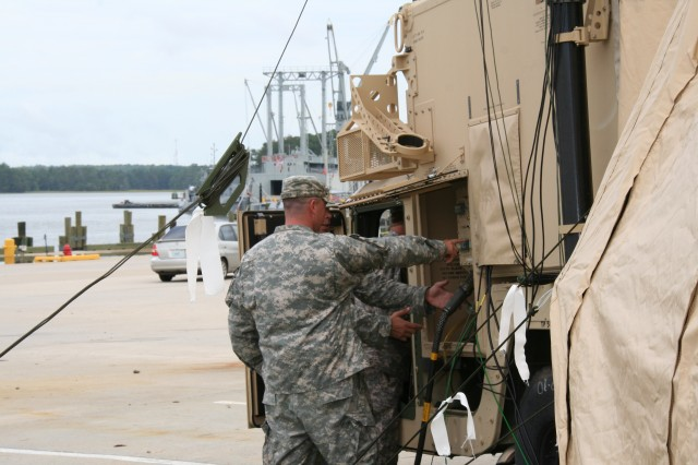 Soldiers train on a Rigid Wall Shelter during the Harbormaster Command and Control Center Battle Command System of Systems Integration Training Sept. 8, 2011, at Fort Eustis, Va.