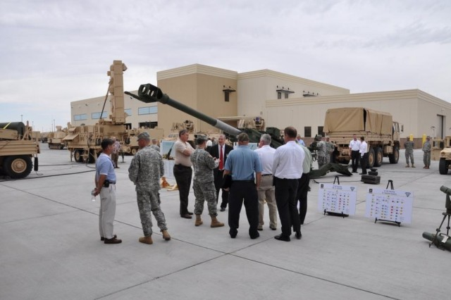 Industry Representatives visit the 4th Battalion, 27th Field Artillery Regiment motor pool at Fort Bliss, Texas, to discuss the unit's role in the Army's Network Integration Evaluations, and the see the equipment it possesses.