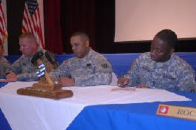 Colonel Johnnie L. Johnson Jr. and Command Sgt. Maj. Mark Aaron are the first to sign the Marne Pride Anti-Drinking and Driving Pledge during a ceremony at Kelley Hill, Sept. 9.