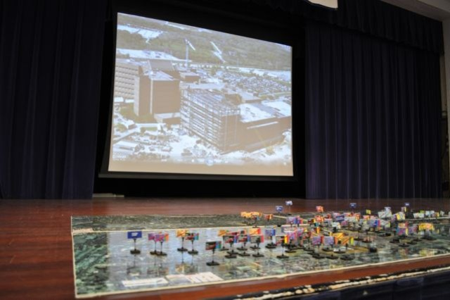 A model of Joint Base San Antonio BRAC 2005 projects is displayed in front of a video depicting each project's construction progress at a press conference Sept. 14.