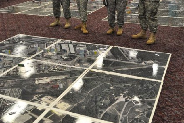 JBSA military members observe a model of BRAC 2005 projects in San Antonio.