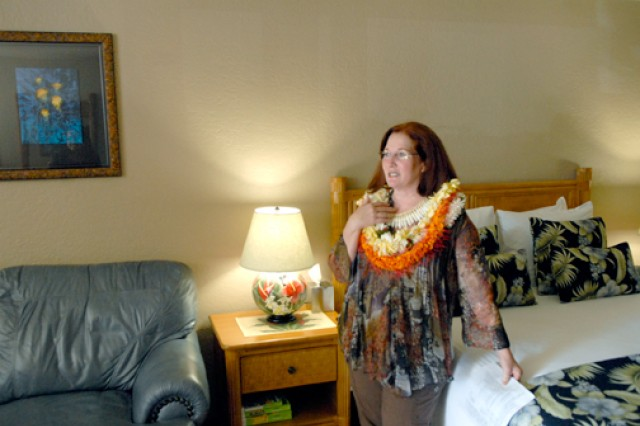 Pauline Barney, general manager, Inn at Schofield Barracks, shows one of the Inn's five newly refurbished rooms. The rooms feature large screen TVs, leather sofas and high-end coffee makers.