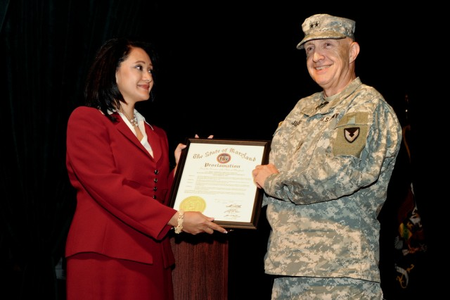 Senior APG commander Maj. Gen. Nick Justice (right) receives an official proclamation signed by Maryland Gov. Martin O'Malley from Asuntha Chiang-Smith Sept. 15 at Aberdeen Proving Ground, Md.