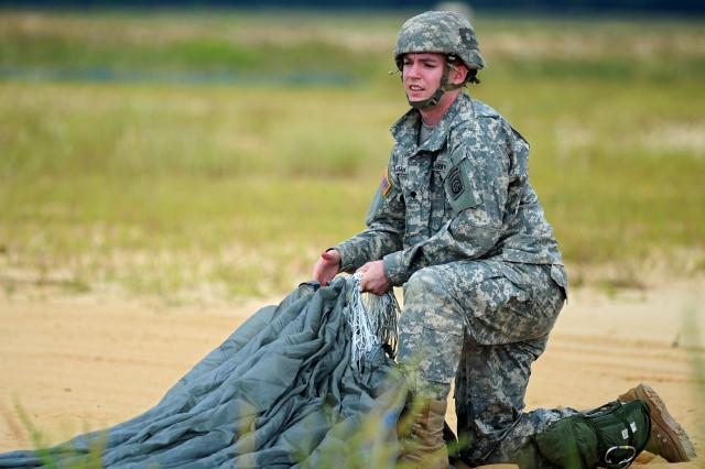 An XVIII Airborne Corps, 82nd Airborne Division paratrooper gathers  her parachute after a successful landing during the Joimnt Operational Access Execise Sept. 8, 2011, on Fort Bragg, N.C.