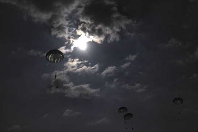 U.S. Army paratroopers from the XVIII Airborne Corps perform a night jump during Joint Operational Access Exercise at Ft. Bragg, N.C., Sept. 9.  The JOAX is a one-week exercise to prepare Army and Air Force units at Fort Bragg to better respond to worldwide crises and contingencies.