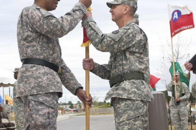 """SHAW AIR FORCE BASE, S.C. (September 16, 2011) """" Third Army/ ARCENT Commanding General, Lt. Gen. Vincent K. Brooks, passes the unit colors to Command Sgt. Maj. Stephan Frennier, incoming Third Army/ ARCENT command sergeant major, during a change of responsibility ceremony in front of Third Army/ ARCENT headquarters, Patton Hall. The transfer of the Colors from Lt. Gen. Brooks to Command Sgt. Maj. Frennier signifies the trust and confidence that our Army places in the noncommissioned officer corps. """"The Army is the strength of the nation, the Soldier is the strength of the Army, the NCO is the backbone of the Army,"""" said Lt. Gen. Brooks. (Photo by Army Staff Sgt. Mylinda D. DuRousseau, Third Army/ ARCENT Public Affairs)"""