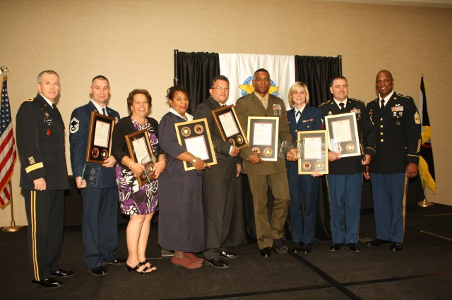 Maj. Gen. Kevin A. Leonard (left), commanding general of SDDC, presented Excellence in Traffic Management Awards to Senior Master Sgt. Charles Nimmo, U.S. Air Force; Audrey Kucway, DCMA; Donna Jones, AAFES; Robert Cordero-Morales, U.S. Navy; Gunnery Sgt. Dwight Hilton, U.S. Marine Corps; YN3 Jillian Oliveira, U.S. Coast Guard; Sgt. 1st Class Chad Parkening, U.S. Army and Command Sgt. Maj. James Riddick, Command Sergeant Major for SDDC. Helene Tunney (not pictured), DLA, also received an award.