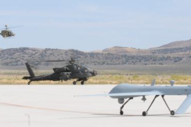 The OH-58D Kiowa Warrior, AH-64D Apache Longbow and MQ-1C Gray Eagle land at Michael Army Airfield, Utah, Sept. 16, 2011, after the Manned Unmanned. The aircraft joined with the RQ-11B Raven and MQ-5B Hunter to demonstrate their interoperability during the MUSIC Exercise Sept. 16, 2011.