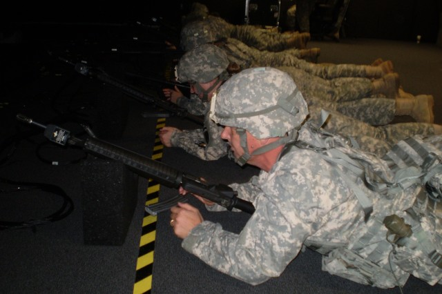 Soldiers from the U.S. Army Reserve's 418th Civil Affairs Battalion qualify on the M-16 using the Essential Skills Trainer, a computerized range incorporating real weapons. The battalion qualified Soldiers from C and D Companies using the Essential Skills Trainer.