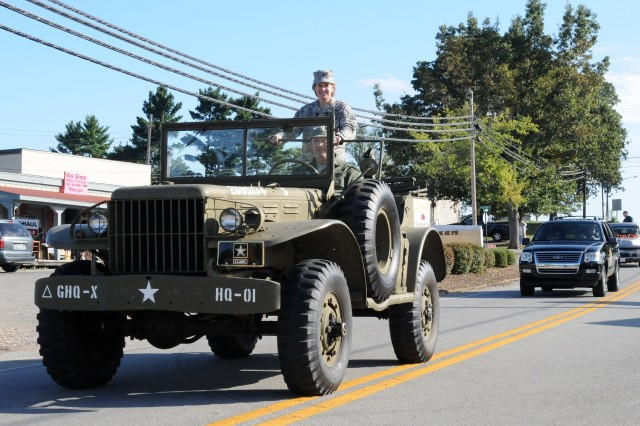 "Vine Grove, Ky. (Sept. 17, 2011) "" Col. Kristin French, commander of Fort Knox's 3d Sustainment Command (Expeditionary), leads the Autumn Daze parade from a old military jeep through Vine Grove, Ky., Sept. 17. Vine Grove has hosted the festival for the past 51 years. (U.S. Army photo by Sgt. 1st Class Rob Strain)"