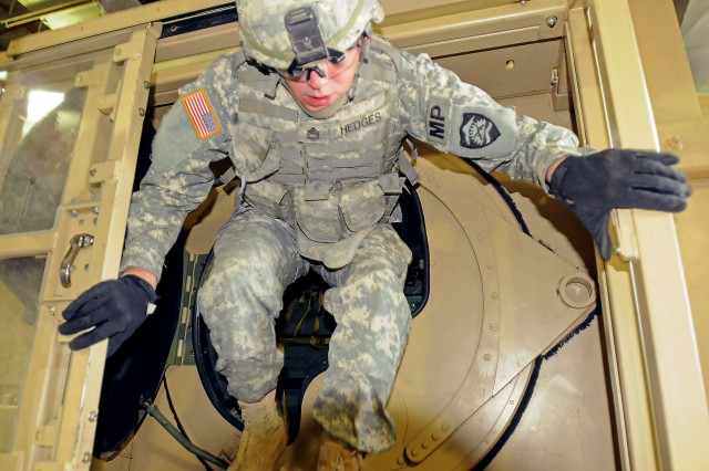 Sgt. 1st Class Richard Hedges, from the 1186th Military Police Company, Oregon Army National Guard, exits the Humvee Egress Assistance Trainer during pre-mobilization training at Umatilla Chemical Depot in Hermiston, Ore., Sept. 15, 2011. The 1186th Military Police Company is training for their deployment to Afghanistan supporting Operation Enduring Freedom.