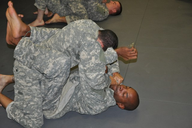 Chicago Battalion recruiter Staff Sgt. Calvin Lee tries to fend off Staff Sgt. Julian DeJeasus during Combatives Level One Training at the Arlington Heights Military Police Reserve unit headquarters.