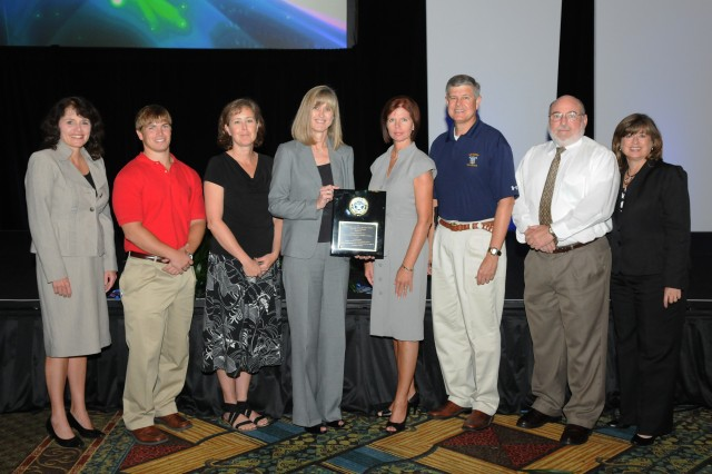 Senior leaders from the Engineering Directorate stand with the newest winners of the 2011 Diminishing Manufacturing Sources and Material Shortages Organization Achievement Award. The award was presented during the DMSMS Conference August 30. From left to right are Dr. Amy Grover, Manufacturing Science and Technology Division Chief; Members of the Obsolescence Management Branch Thomas Hibbett, Melissa Hildreth, Lynne Marinello, Michele Ozier, Bob Hawkins, Ray Morgan; and Patti Martin, Director of the Engineering Directorate.