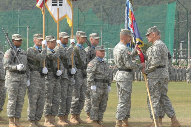 Major Gen. Edward C. Cardon (left), the newly appointed commander of the 2nd Infantry Division, accepts the division guidon from Lt. Gen. John D. Johnson, commander of 8th Army, during a change of command ceremony held Sept. 20 at Indianhead Stage Field on Camp Casey.