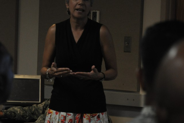 Kim Milano, a nutritionist, speaks to a group of noncommissioned officers during a presentation. Milano is one of several presenters slated to teach workshops during the SELF Symposium Sept. 30.