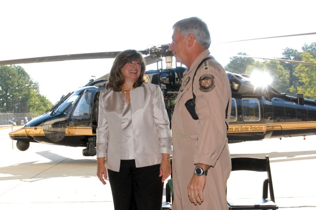 AMRDEC engineering director Patricia Martin talks with Michael Kostelnik, assistant commissioner of U.S. Customs and Border Protection, Office of Air and Marine.