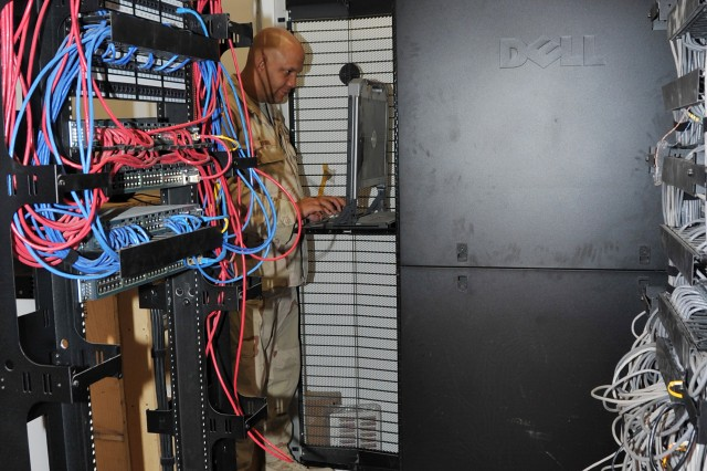 Chris Brooks, chief, information technology section at the Afghanistan Engineer District-South performs diagnostic testing in the district's server room on its Kandahar headquarters compound. (USACE Photo/Karla Marshall)