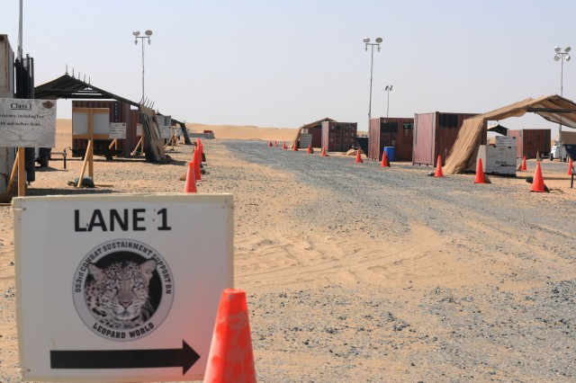 The lanes of the Four Corners site at Camp Virginia, Kuwait, took roughly 30 days to set up, and stands ready to process convoys leaving Iraq due to the presidential directive.
