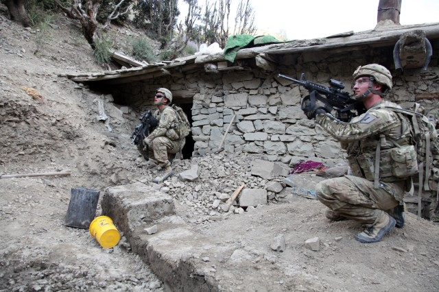 Soldiers from Blackfoot Troop, 6th Squadron, 4th Cavalry Regiment, 3rd Brigade Combat Team, 1st Infantry Division, Task Force Duke, pull security near a house while it is being searched during Operation Tofan II, near the village of Suri Kheyl, Waze Zadran District, Afghanistan, Sept. 15, 2011. The operation's main objective was to clear insurgents from the vicinity of Suri Kheyl and to prevent them from returning.