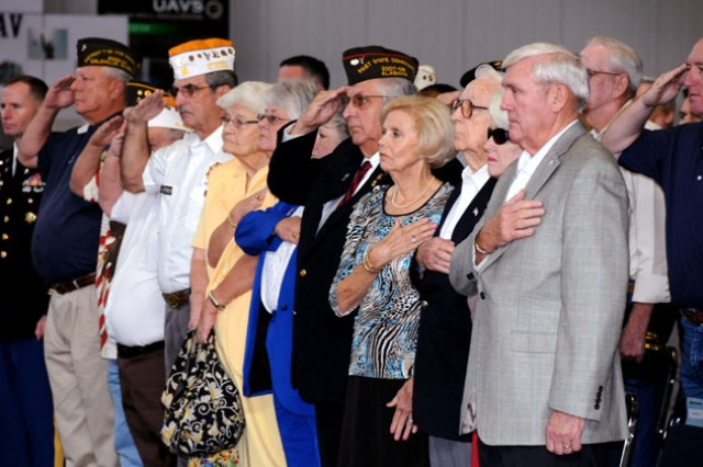Members of the surrounding communities and various veterans groups from around the Wiregrass salute the colors during a National POW/MIA Recognition Day ceremony at the U.S. Army Aviation Museum Sept 16.