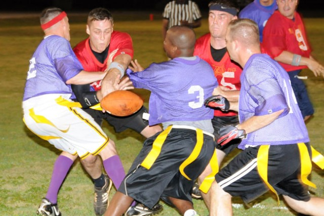 Team Biscuits quarterback Chris Simpkins pushed the ball over the goal line during the team's game against the 164th TAOG in the opening game of Fort Rucker's Intramural Football preseason Monday. The Biscuits won, 22-0.
