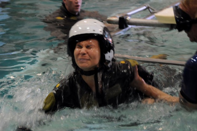 Julia Hartley emerges after completing the underwater training portion of Aviation Spouse Day Sept. 16.
