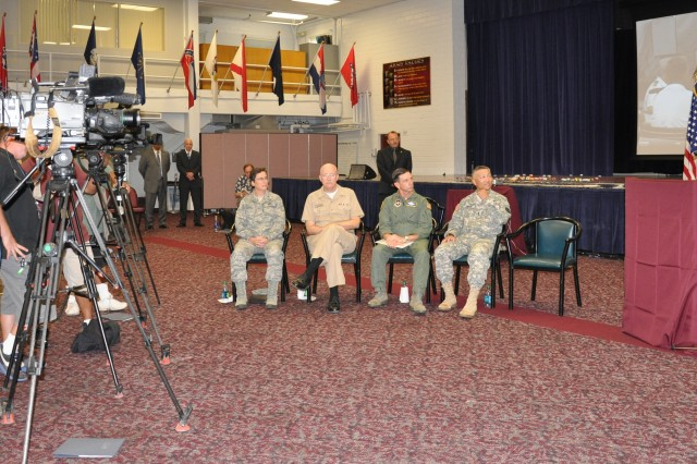 "Dr. ""CEM Maxwell (far right), deputy director of the San Antonio Joint Program Office, addresses members of the media Sept. 14, 2011, at Fort Sam Houston, Texas."