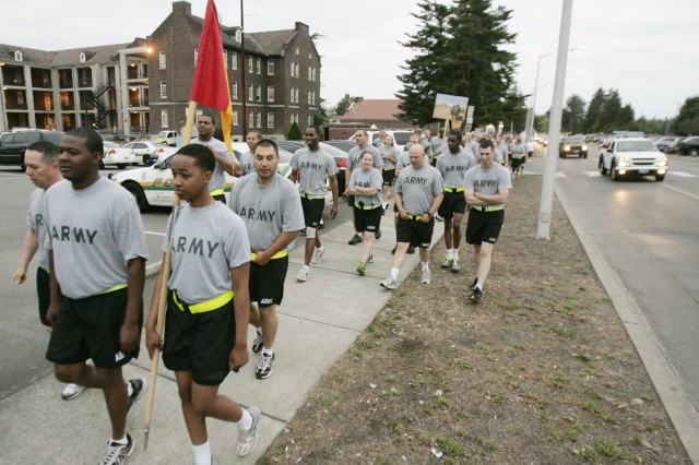 Soldiers walk down Pendleton Ave., at the start of the Walk 4 Life.
