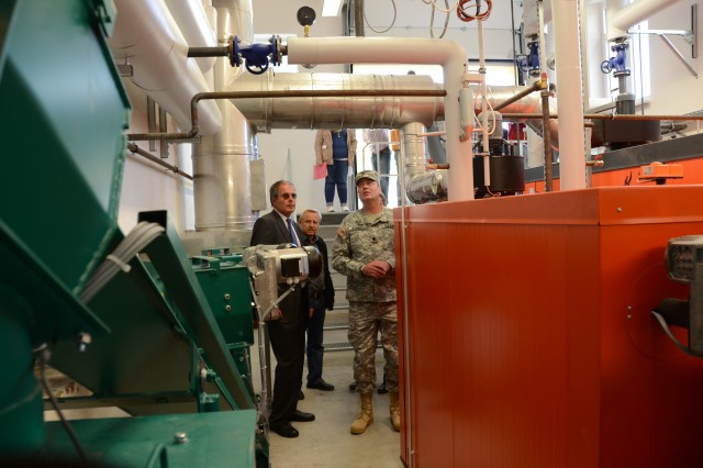 Director of Stadtwerke Bamberg Klaus Rubach, left, and U.S. Army Garrison Bamberg Commander Steven L. Morris, right, take a tour through the a new biomass heating facility that will provide heated water to housing units near Muna Depot, Germany.